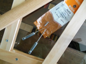 Plexi-glass doors made from trim woods.  Make sure to pre-drill glass with smallest bit first, graduating to next size(s) up to accommodate your screws.