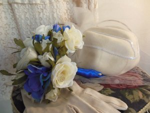 The bride will wear vintage- hat and gloves 1930's finds.  It helps to have a friend who works at a second-hand shop.  Shooshie has collected all kinds of beautiful vintage wear since she was a teenager.