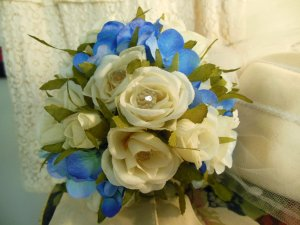 Close up of the bridal bouquet.  Shoosh wanted something small and vintage-y.  She also wanted something she could keep, so we went with silk cream roses and rosebuds and blue hydrangeas.  Crystal faceted beads are wired into the center of the open roses.