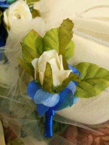 Grandpa's boutonniere.  A rosebud with hydrangeas.