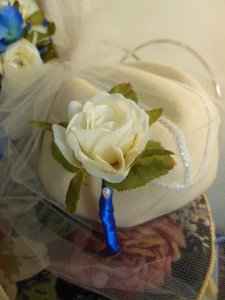 The groom's boutonniere.  A single white rose.